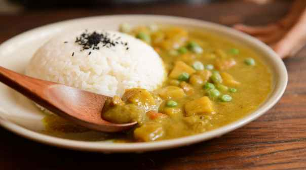 cooked rice and curry food served on white plate